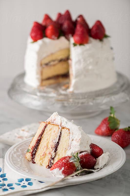 Slcie of Vanilla Stawberry Cake by Jeff Wasserman for Stocksy United