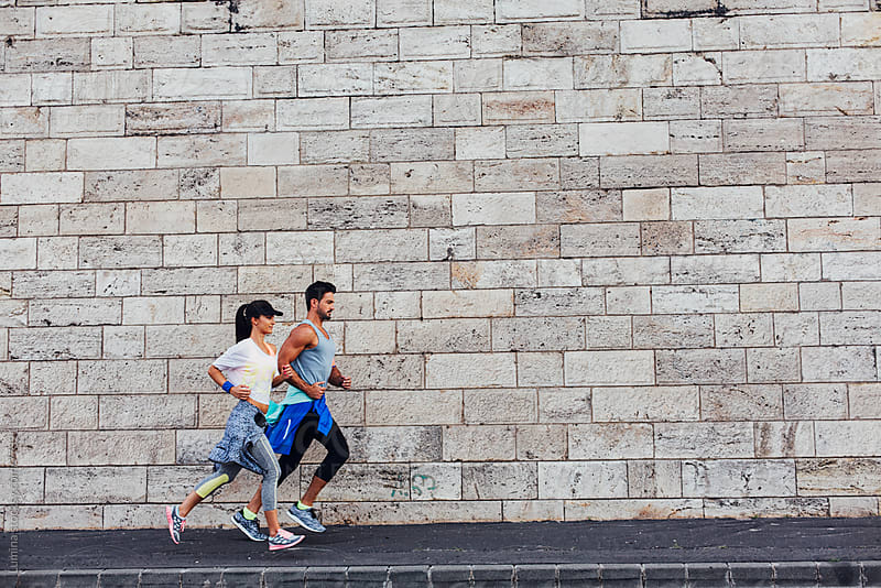 Couple Jogging Together by Lumina for Stocksy United