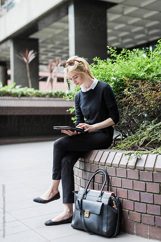 Young Business woman using a digital tablet outdoor by Mauro Grigollo for Stocksy United