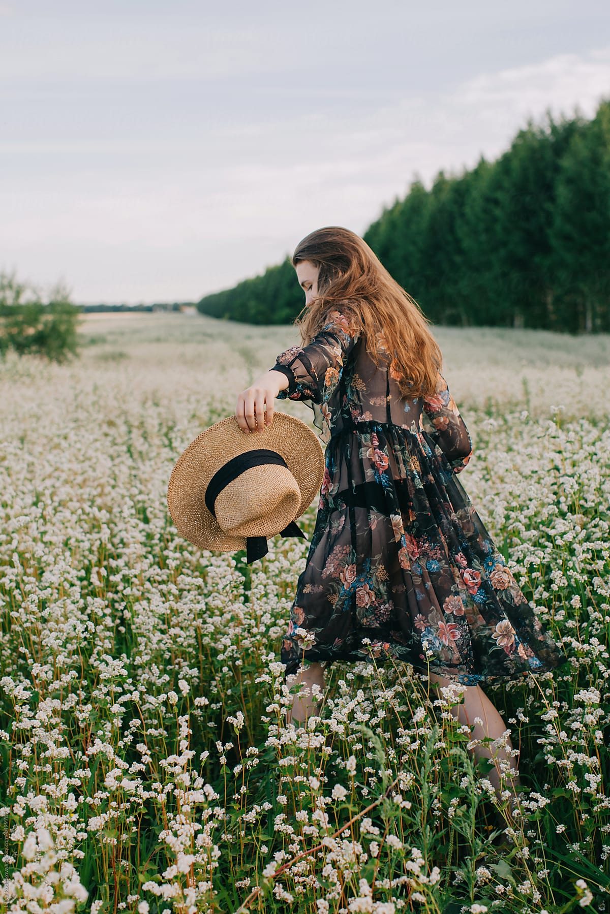Back View Portrait Of Young Fashionable Female Walking Through The