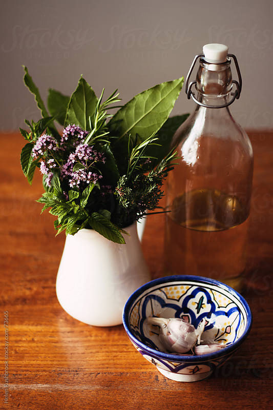 Herbs, garlic and Olive oil by Helen Rushbrook for Stocksy United