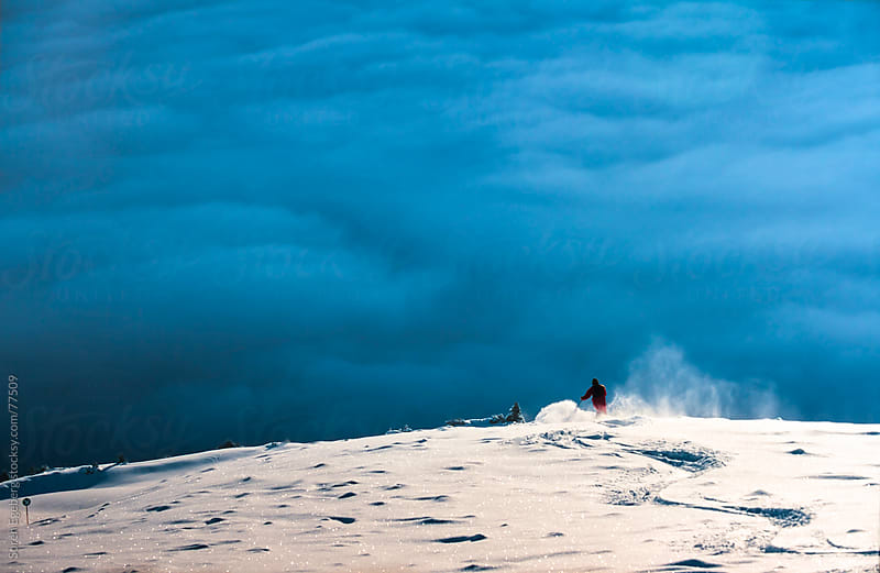 Winter snow skiing in the mountains by Soren Egeberg for Stocksy United