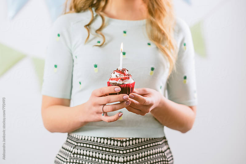 Woman Holding a Birthday Capcake by Aleksandra Jankovic for Stocksy United