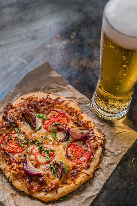 Tomato and Onion Pizza with Beer by suzanne clements for Stocksy United