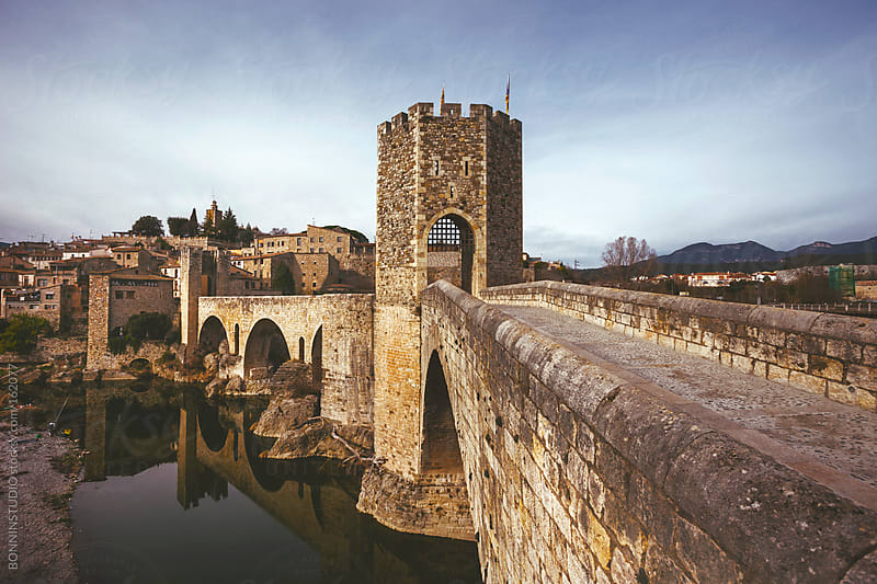 View of the bridge and medieval village of Besalu. Girona, Spain. by BONNINSTUDIO for Stocksy United