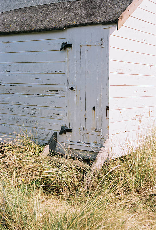 Beach hut among the sand dunes at Old Hunstanton, Norfolk, UK. by Liam Grant for Stocksy United