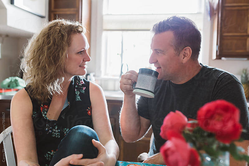Couple having coffee together at home by Carey Shaw for Stocksy United