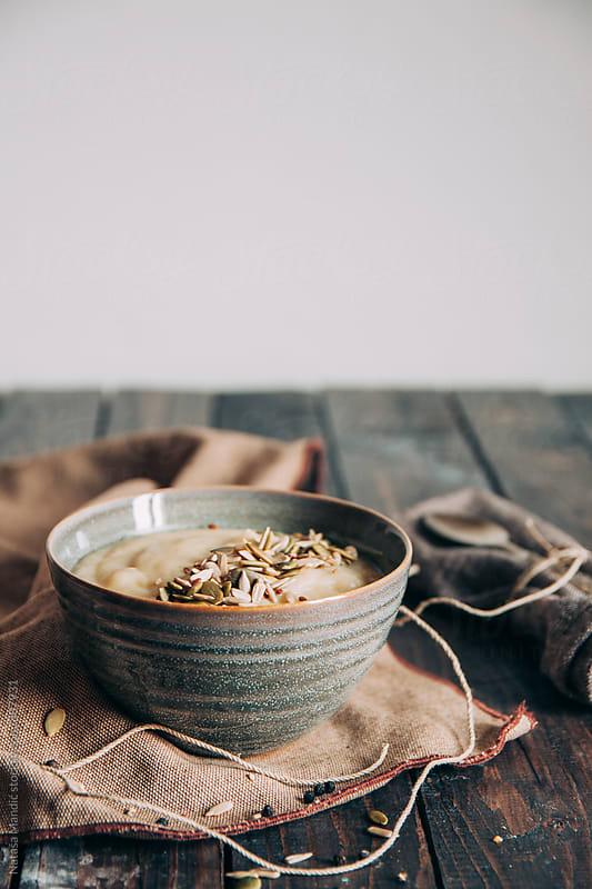 Cauliflower soup with seeds garnish by Nataša Mandić for Stocksy United