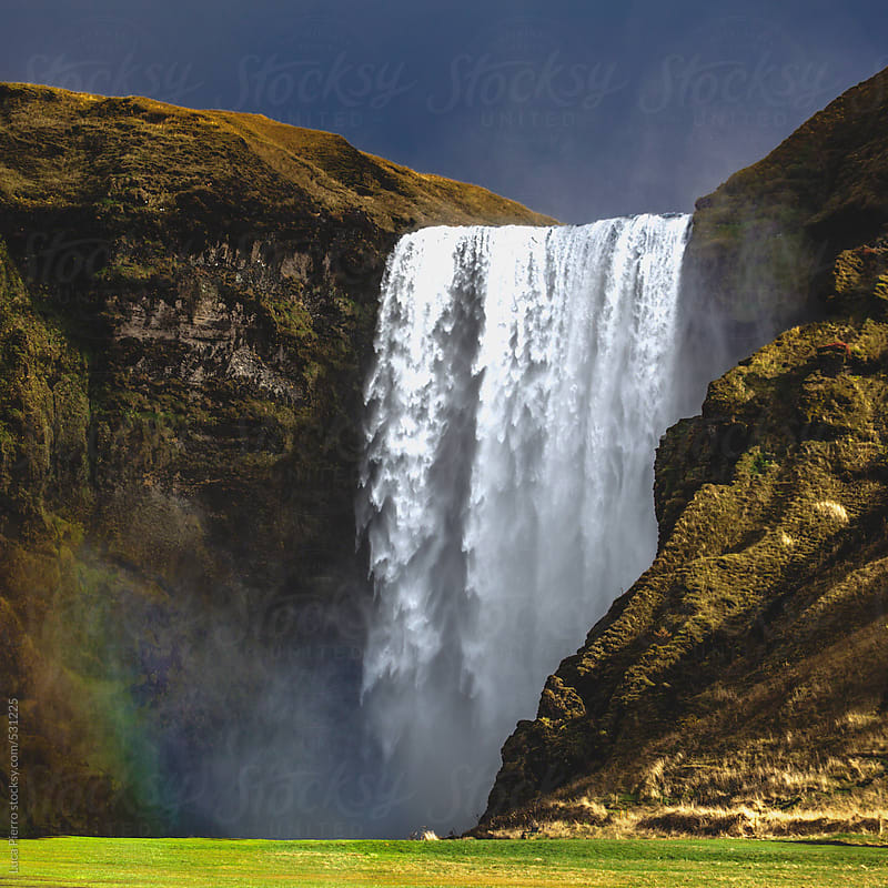 Skógafoss waterfall, Iceland by Luca Pierro for Stocksy United