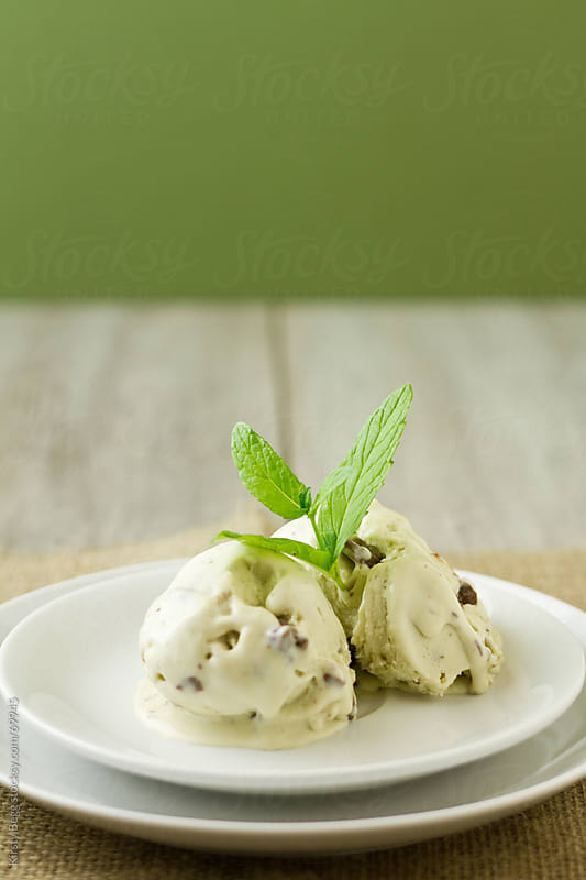 Mint and chocolate ice cream, garnished with spearmint by Kirsty Begg for Stocksy United