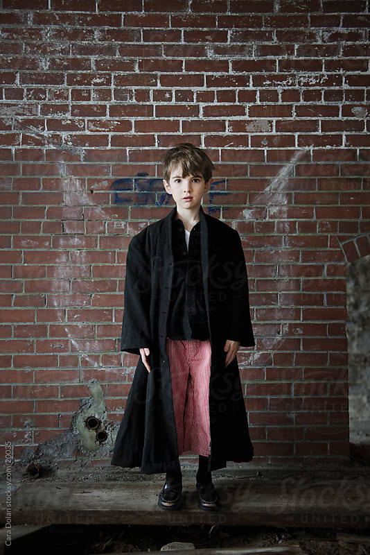 Boy has graffiti wings in an abandoned brick building by Cara Dolan for Stocksy United
