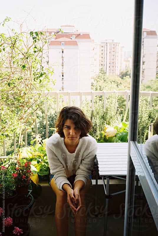 A girl on the balcony by Aleksandra Martinovic for Stocksy United