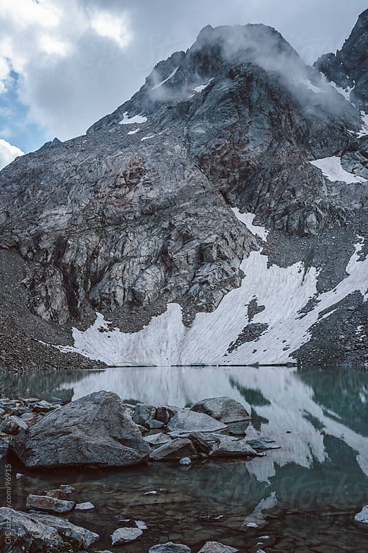 Glacier with frozen snow and lake by GIC for Stocksy United