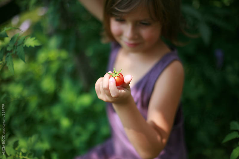 Girl With a Tomato by ALICIA BOCK for Stocksy United