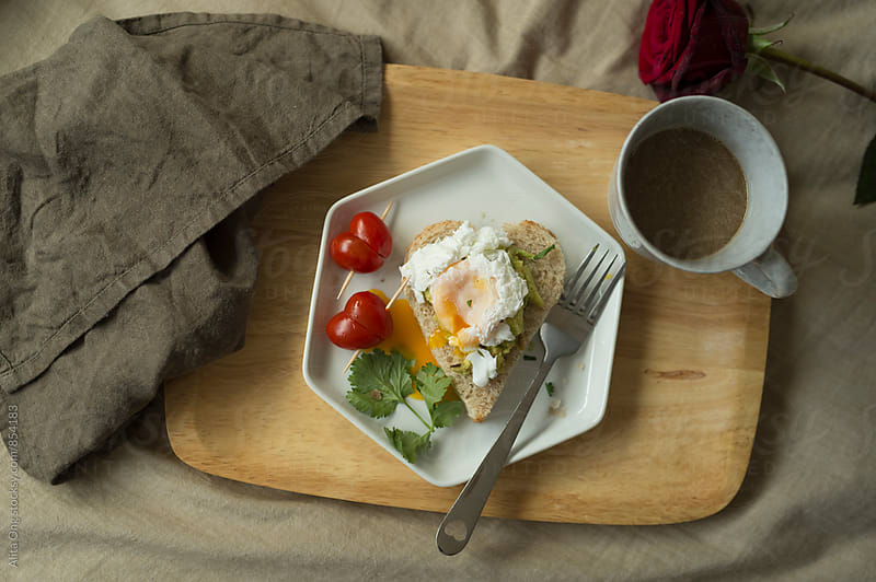 Breakfast in bed by Alita Ong for Stocksy United