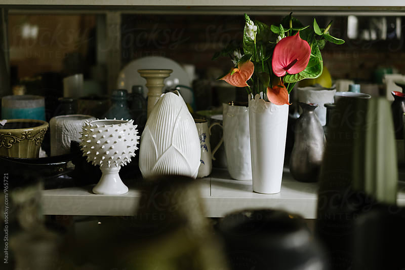 Shelf With Empty Vases And Bouquet Of Flower Stocksy United