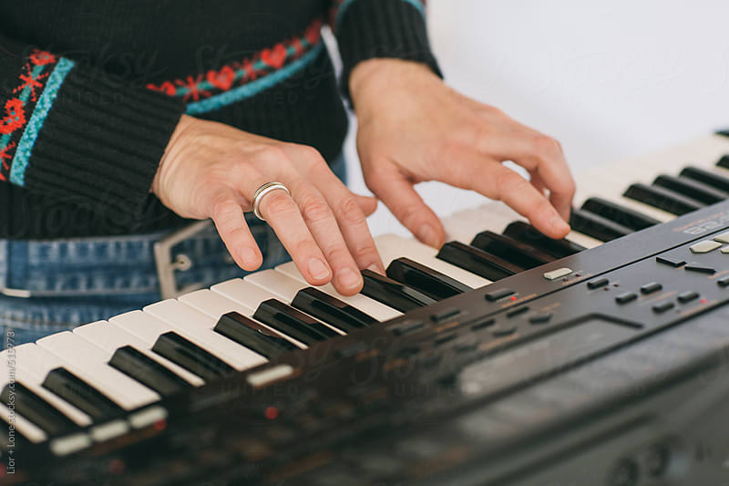 Female musician playing the piano by Lior + Lone for Stocksy United