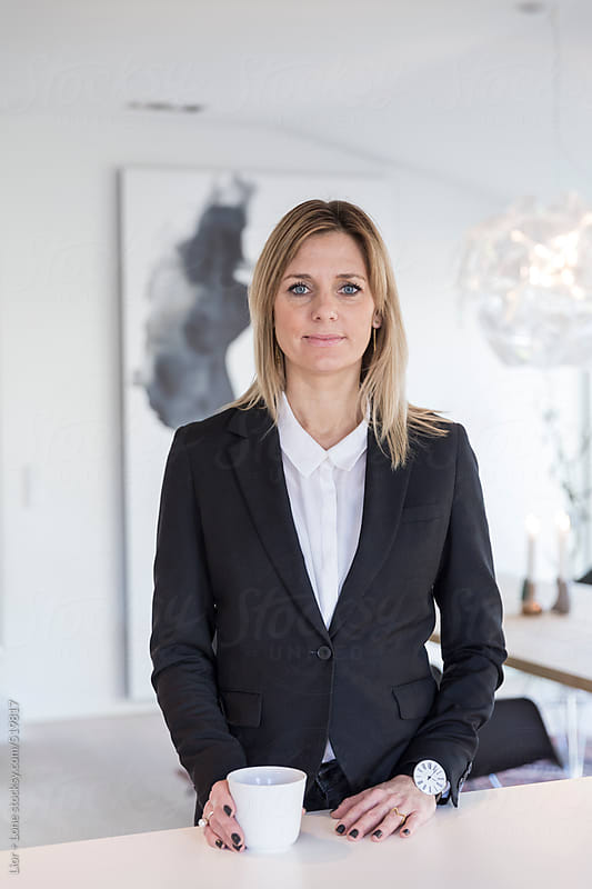 Portrait of businesswoman in black suitjacket by Lior + Lone for Stocksy United