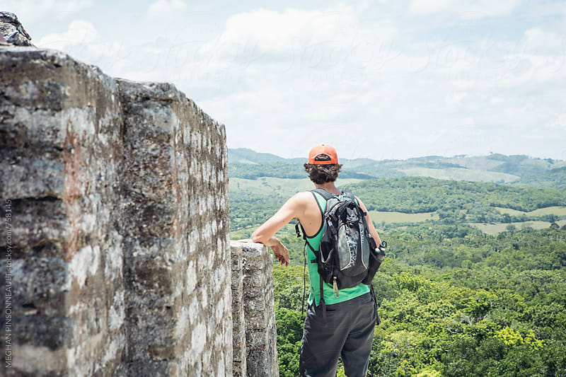 Man Enjoying View From Atop Ancient Mayan Temple by MEGHAN PINSONNEAULT for Stocksy United