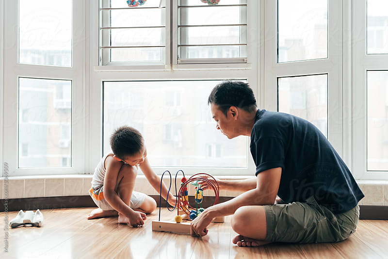 Father and son playing at home by MaaHoo Studio for Stocksy United