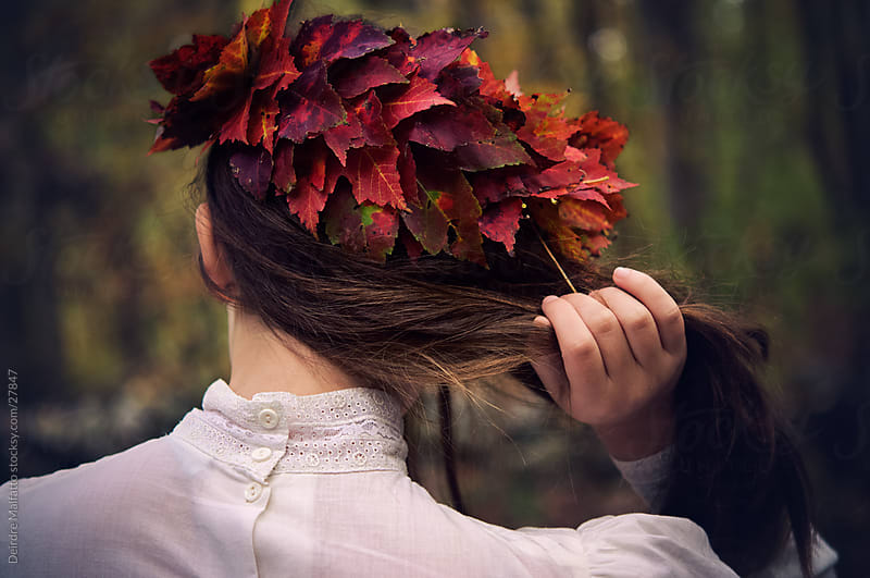 Girl in Wreath Crown of Autumn Leaves by Deirdre Malfatto for Stocksy United