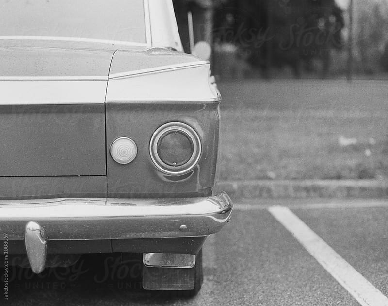 Black and white image of the back of classic american car by Jakob for Stocksy United