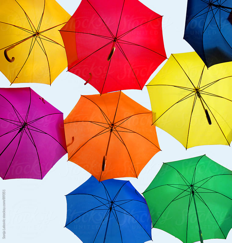 open colorful umbrellas by Sonja Lekovic for Stocksy United
