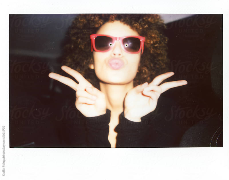 afro young girl real polaroids by Guille Faingold for Stocksy United