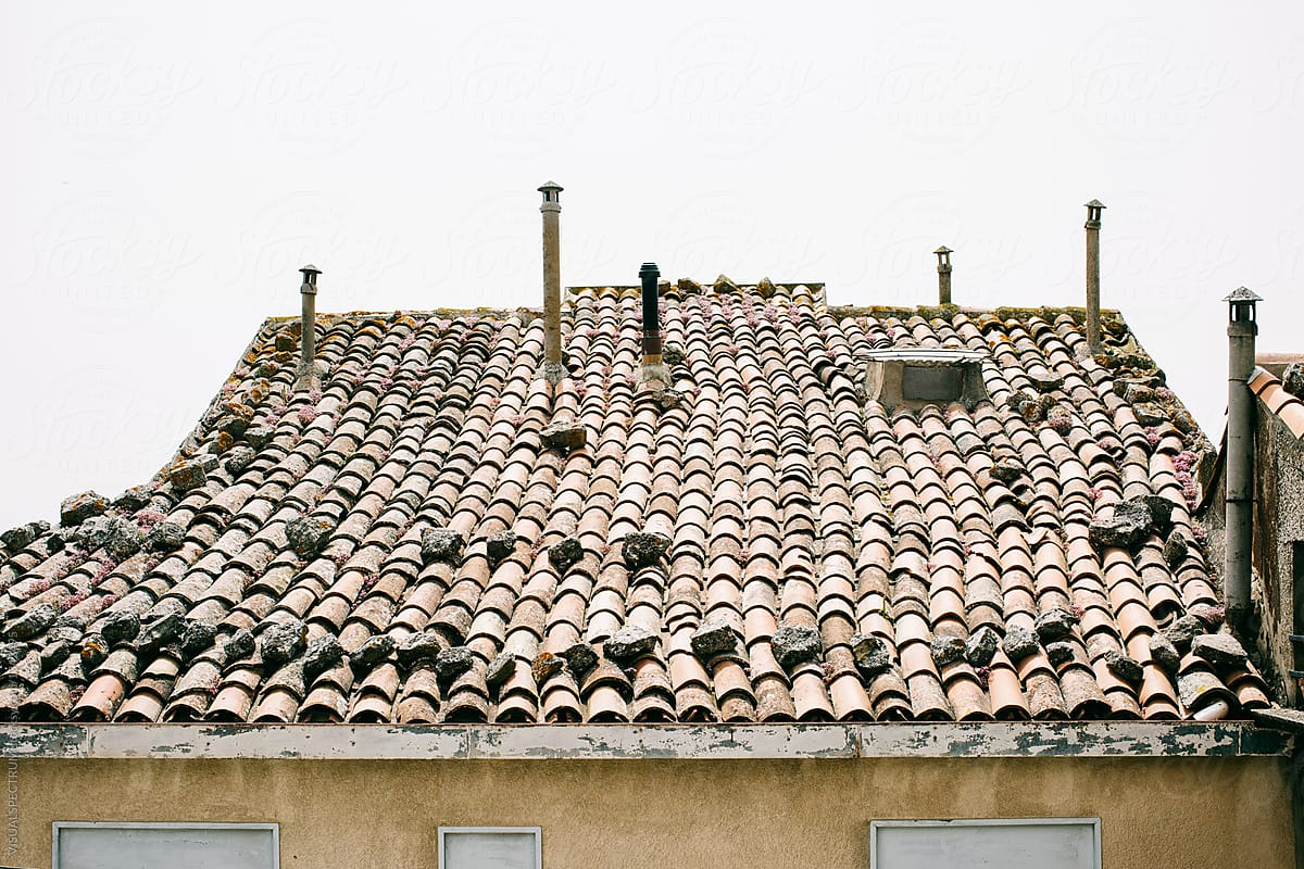 Terracotta Roof Tiles and Chimneys on Old-Fashioned Roof by