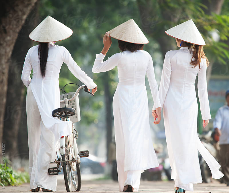 Vietnamese women in traditional costume. Vietnam. by Hugh Sitton for Stocksy United