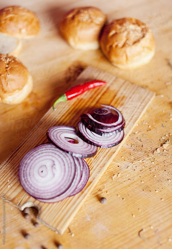 Onion on cutting board by Milles Studio for Stocksy United