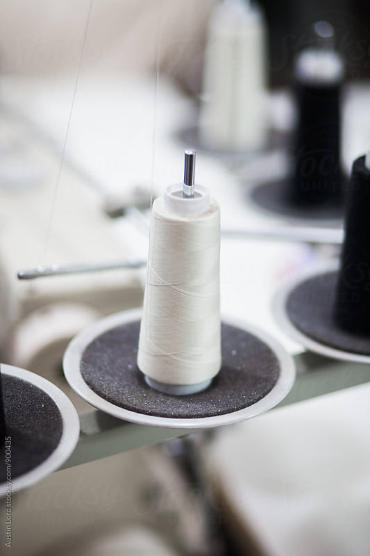 Spool of white thread. by Austin Lord for Stocksy United