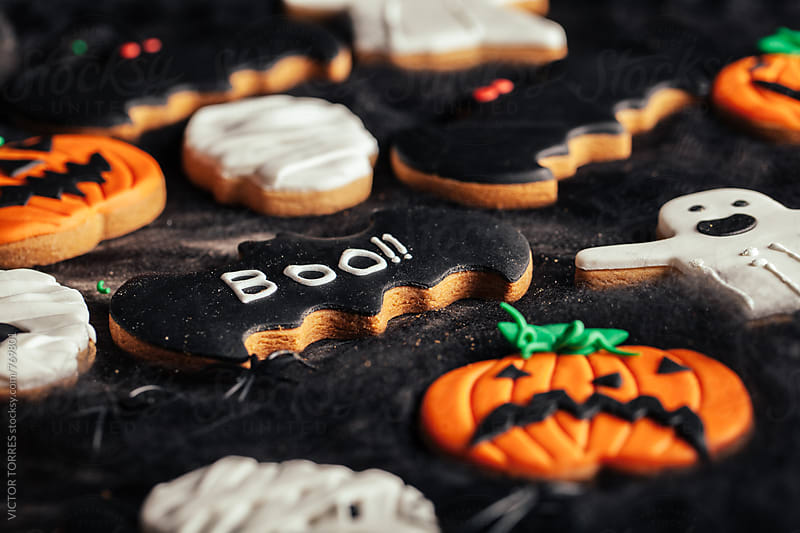 Halloween Biscuits over a Black Spider Web by VICTOR TORRES for Stocksy United