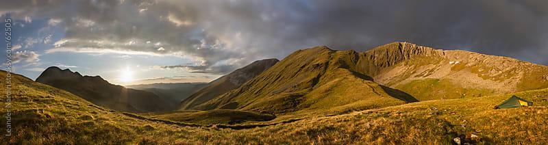 Sunset panorama shot of scottish highlands  by Leander Nardin for Stocksy United