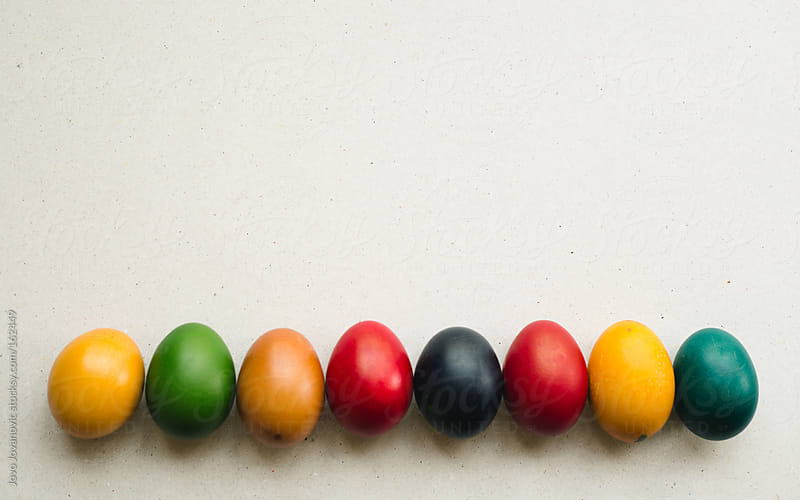 Colorful Easter eggs on white background by Jovo Jovanovic for Stocksy United