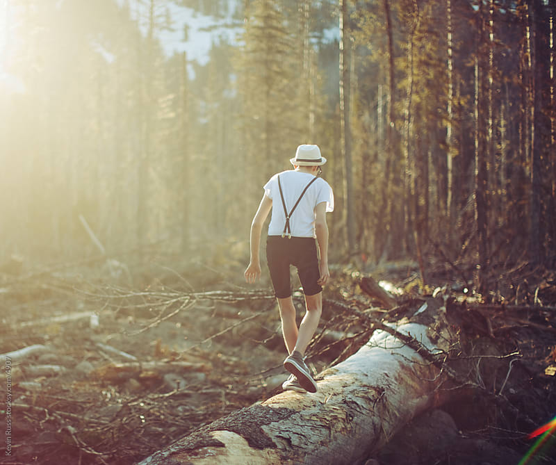 Log Walking Young Man by Kevin Russ for Stocksy United