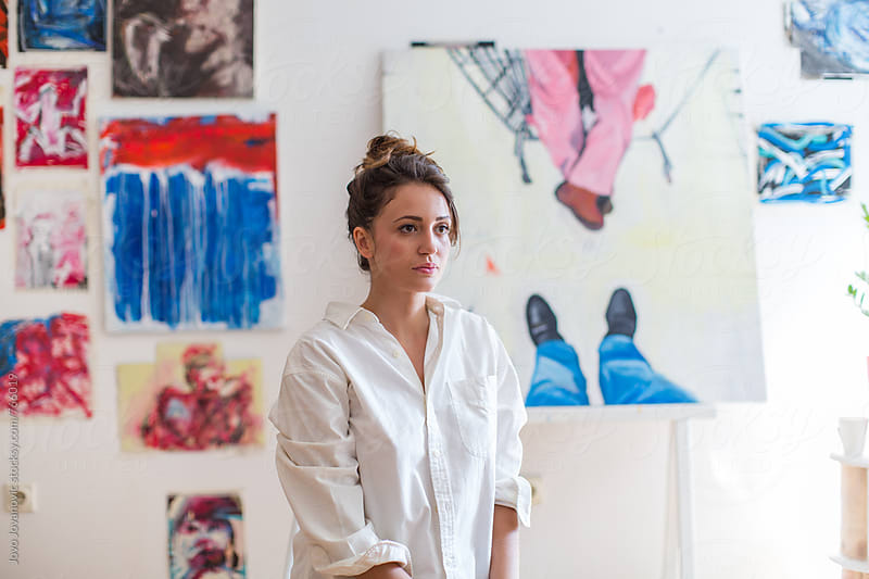 Portrait of a beautiful woman painter in front of her art by Jovo Jovanovic for Stocksy United