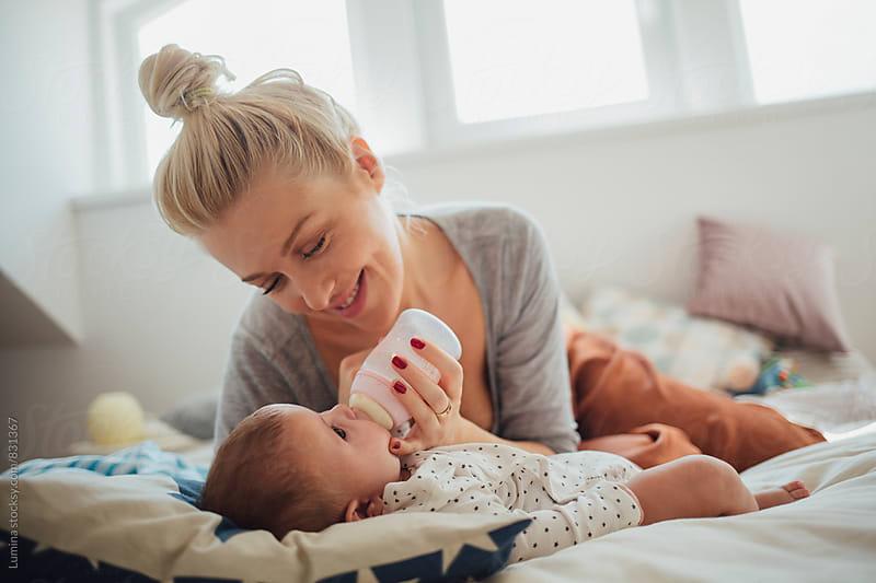 Mother Bottle Feeding Her Baby by Lumina for Stocksy United