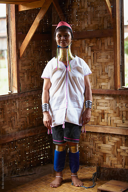 portrait of one senior Long neck woman in Myanmar by Bo Bo for Stocksy United