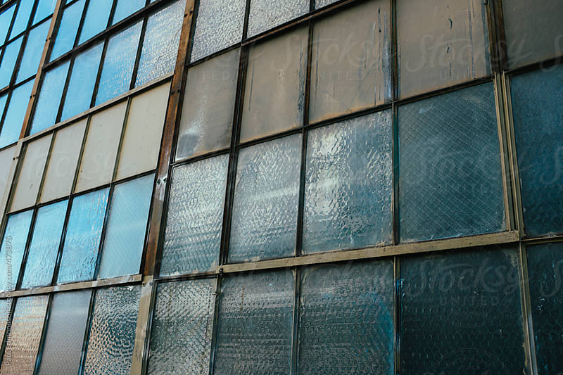 Windows from old warehouse by Paul Edmondson for Stocksy United