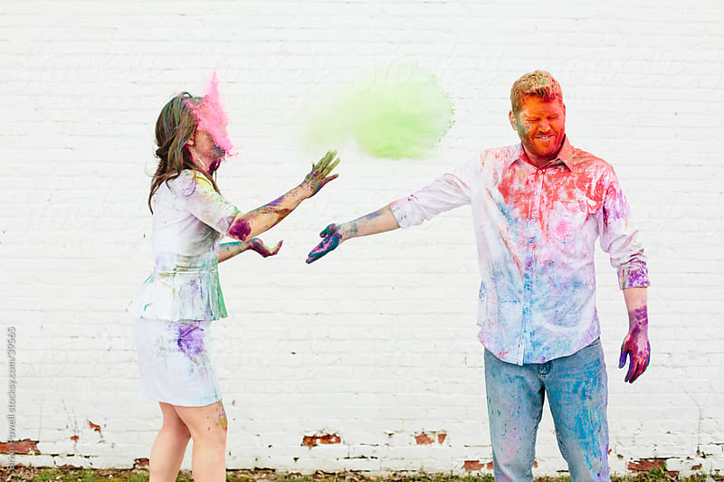 throwing Holi color at each other by Brian Powell for Stocksy United