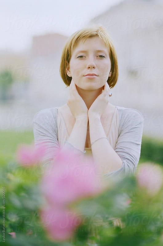 Portrait of young woman in pastel tones by Lyuba Burakova for Stocksy United