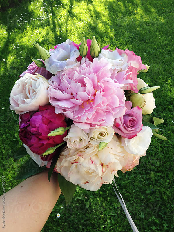 Holding wedding bouquet by Lyuba Burakova for Stocksy United