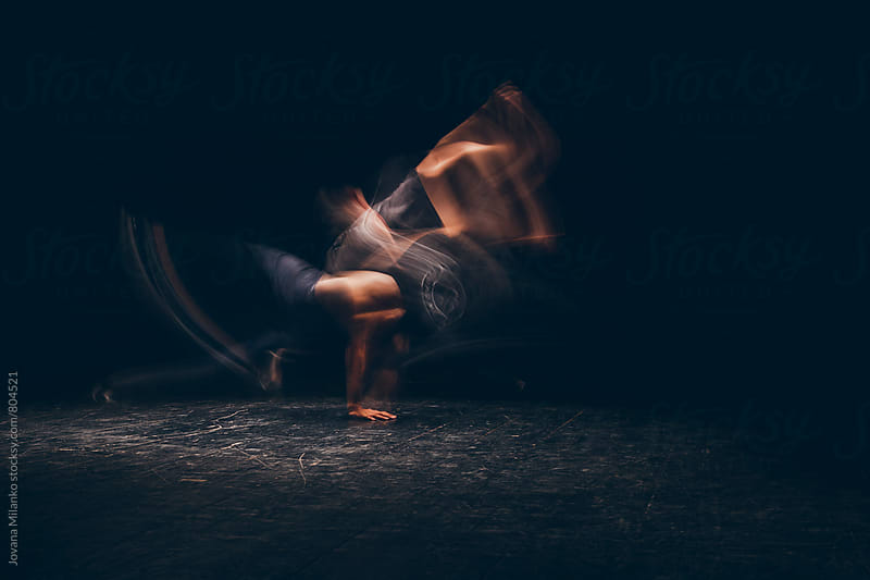 Motion blurred man breakdancing   by Jovana Milanko for Stocksy United
