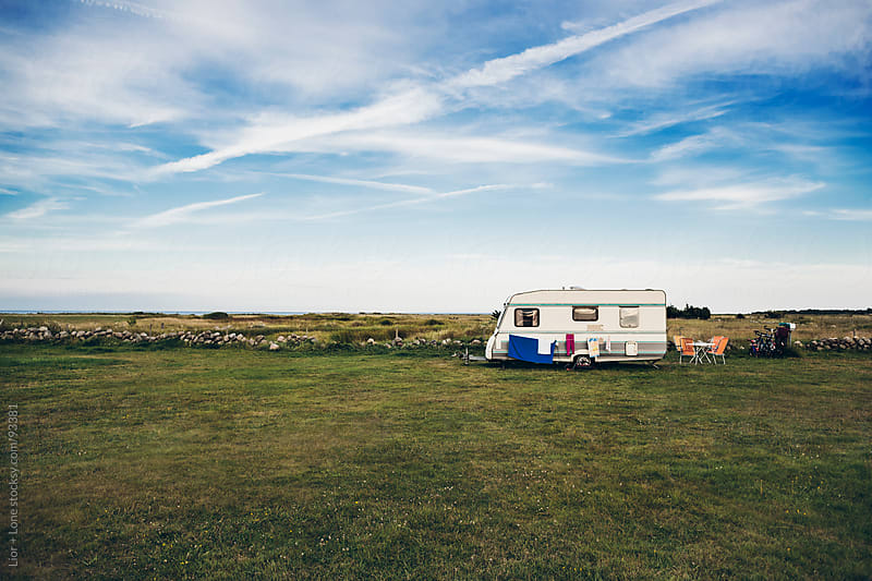 Laundry drying on a caravan in a meadow  by Lior + Lone for Stocksy United