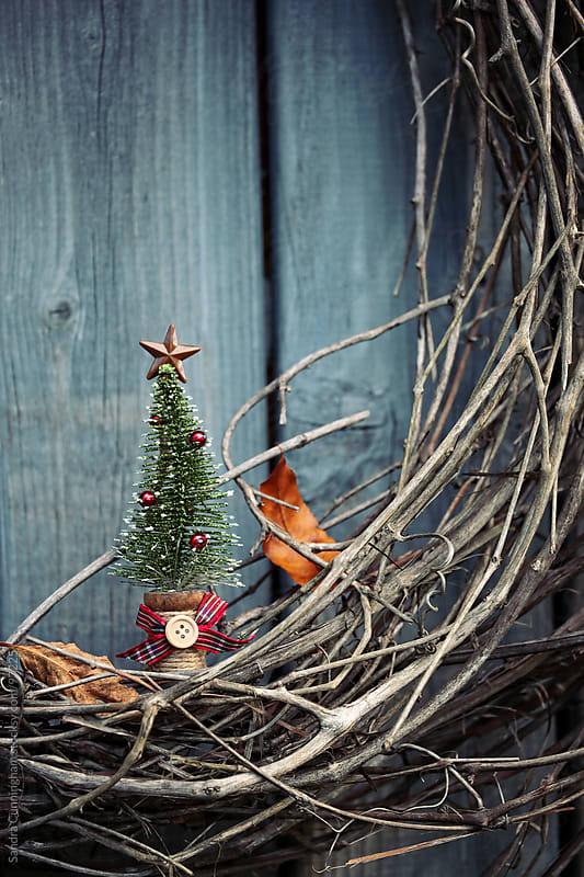 Little christmas tree ornament on wreath by Sandra Cunningham for Stocksy United