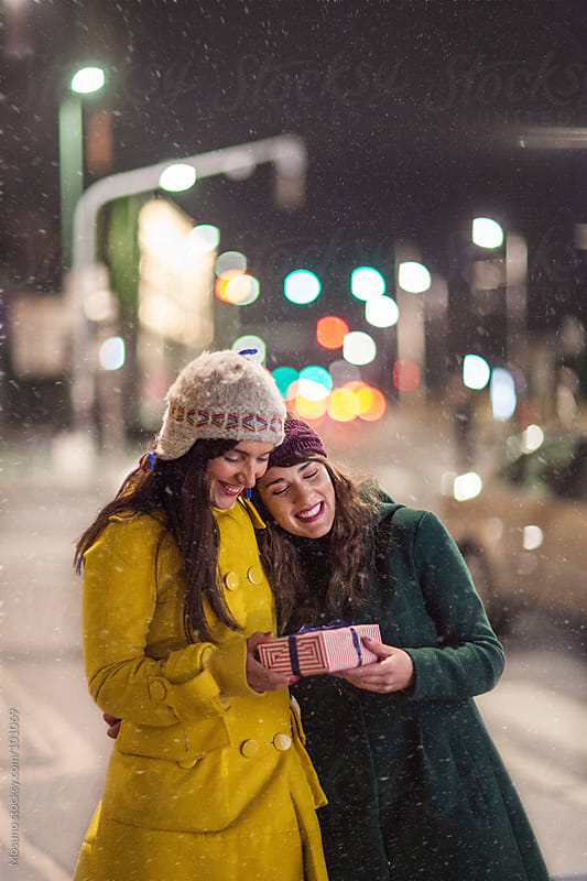 Friends Enjoying Winter in the City by Mosuno for Stocksy United