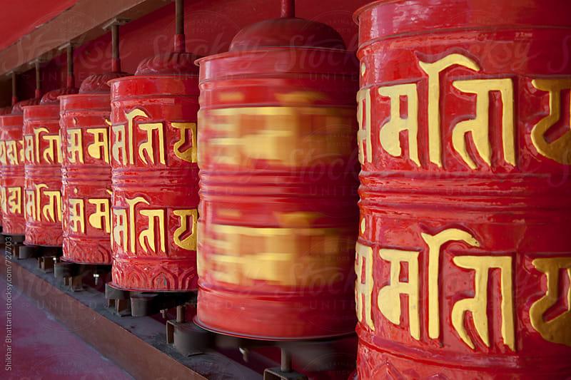 Spinning in motion prayer wheels. by Shikhar Bhattarai for Stocksy United