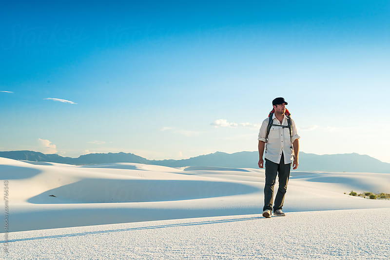 Man Backpacking in White Sands National Monument Hiking to Back Country Campsite by JP Danko for Stocksy United