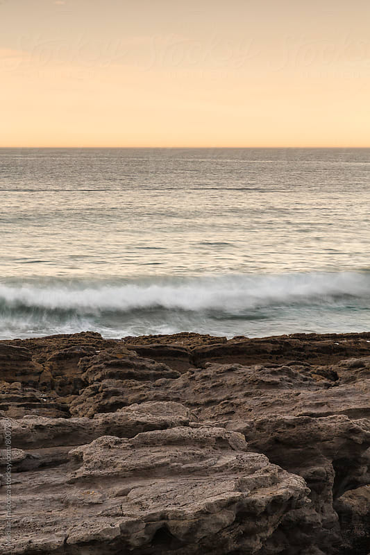 Wave reaching the coast at sunset by Marilar Irastorza for Stocksy United